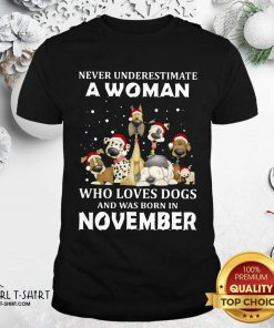 Never Underestimate A Woman Who Loves Dogs And Was Born In November Christmas Shirt - Design By Girltshirt.com